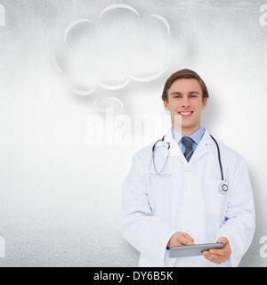 Composite image of young doctor using tablet pc with thought bubble - Stock Photo