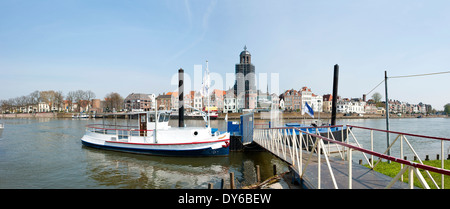 Panoramic view of the city Deventer, an ancient Hanse town in the Netherlands, with ferry at pier from accross the - Stock Photo