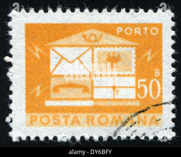 ROMANIA - CIRCA 1982: A stamp printed in the Romania, depicts the postal horn and postal car, circa 1982 - Stock Photo
