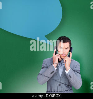 Composite image of angry businessman tangled up in phone wires with speech bubble - Stock Photo