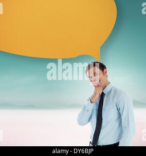 Composite image of thoughtful businessman with speech bubble with hand on chin - Stock Photo