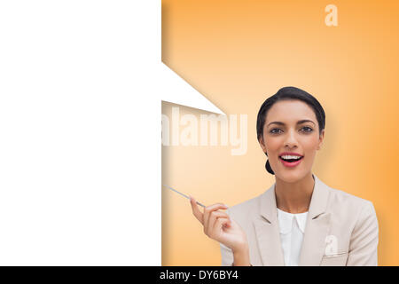 Composite image of smiling businesswoman holding a pen with speech bubble - Stock Photo