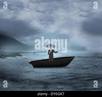Composite image of peaceful businessman holding blue umbrella in a sailboat - Stock Photo