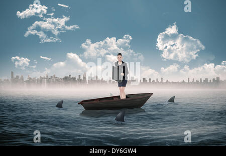 Composite image of elegant businesswoman in suit carrying briefcase in a sailboat - Stock Photo