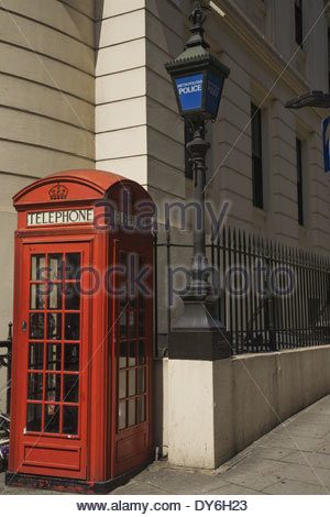 Red London telephone box and A traditional Blue Metropolitan Police street lamp - Stock Photo