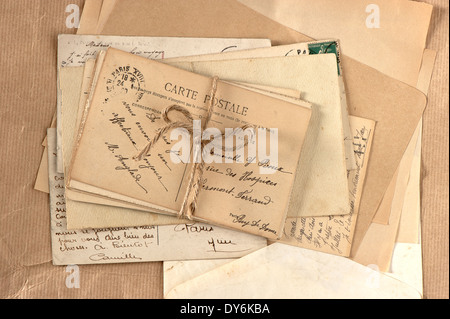 old letters and french postcards. vintage background - Stock Photo