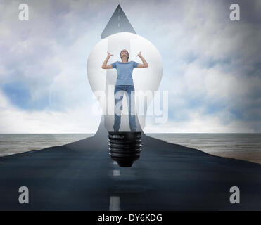 Composite image of angry woman in light bulb - Stock Photo