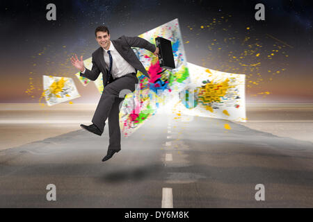 Composite image of smiling businessman in a hurry - Stock Photo