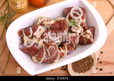 Marinated lamb with onion rings and spices, top view - Stock Photo