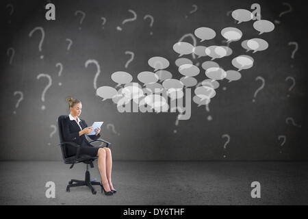 Composite image of businesswoman sitting on swivel chair with tablet - Stock Photo