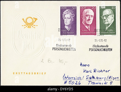 Commemorative first day cover East Germany DDR postage stamps featuring famous East Germans postmarked Berlin 25th - Stock Photo