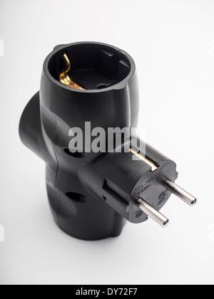 Black triple electric power plug socket - Stock Photo