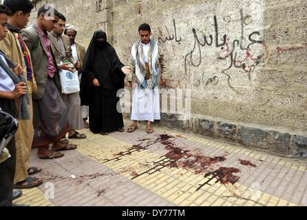 Sanaa, Yemen. 8th Apr, 2014. Blood is seen on the ground near Ismail al-Wazir's car in Sanaa, Yemen, on April 8, - Stock Photo