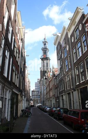 Amsterdam street in old Jordaan Quarter with Westerkerk tower in the background - Stock Photo
