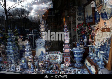 Assortment of Delftware and China in a shop window in Amsterdam - Stock Photo