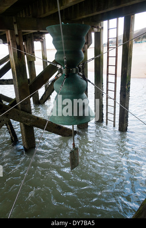 art installation by Marcus Vergette 'Time and Tide Bell' beneath the jetty in Aberdyfi rung by the action of water - Stock Photo