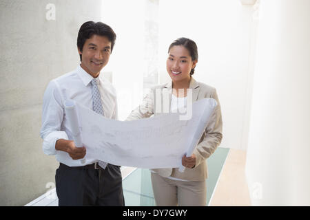 Estate agent looking at blueprint with potential buyer stock photo estate agent looking at blueprint with potential buyer stock photo malvernweather Images