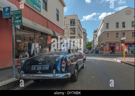 Back view of a black Mercedes 190 parked in a street in Cape Town, Western Cape, South Africa - Stock Photo