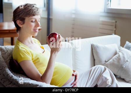 Pregnant woman eating - Stock Photo