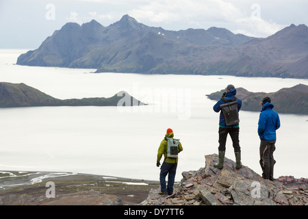 Passengers on an expedition cruise to Anarctica recreat part of Shakleton's famous walk across South Georgia - Stock Photo