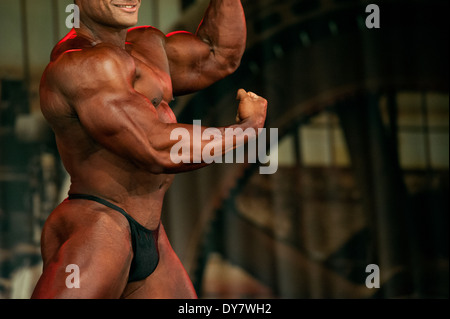 Detail of a male bodybuilder during the fitness fair FIBO in Cologne, Germany, 2014. - Stock Photo