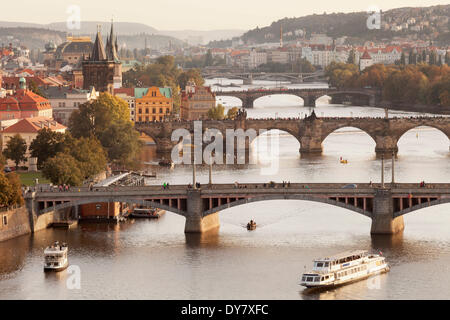 View from Letna hill over the Vltava River with its bridges to the Old Town with the historic Old Town Bridge Tower, Prague Stock Photo