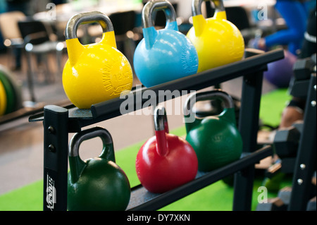 Coloured weights on the fitness fair FIBO in Cologne, Germany. - Stock Photo