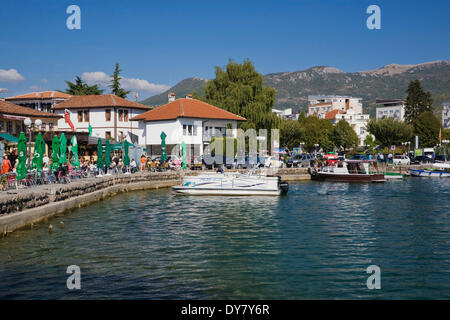 Waterfront and boats moored in Ohrid harbour on Lake Ohrid, Ohrid, Macedonia - Stock Photo