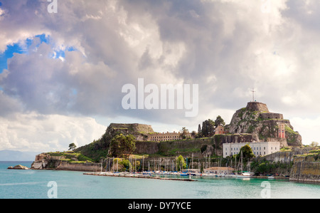The Old Fortress of Corfu Town, Greece. Built by the Venetians it is still used for cultural events despite erosion. - Stock Photo