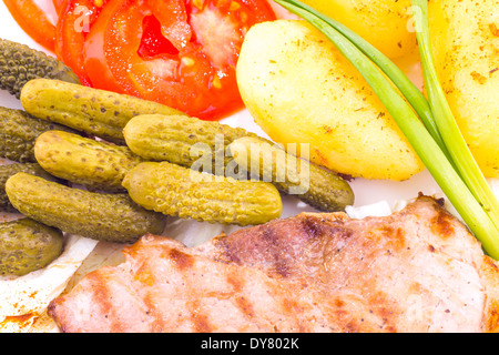 Grilled steak with potato and vegetables - Stock Photo