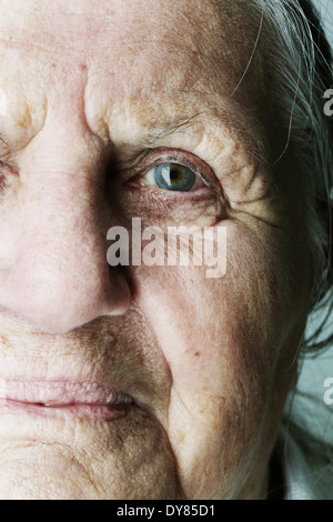 Portrait of senior woman, partial view - Stock Photo
