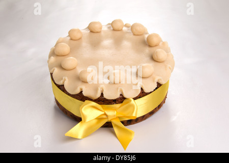 Simnel cake with basic marzipan decoration with a yellow ribbon round it (14 of 35) - Stock Photo
