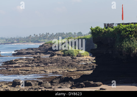 Rocks on the Beach in Tanah Lot Temple area ( Pura Tanah Lot) Bali, Indonesia - Stock Photo