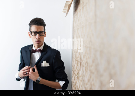 Young man wearing suit and glasses - Stock Photo