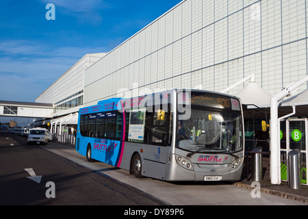Glasgow airport exterior with bus & taxis - Stock Photo
