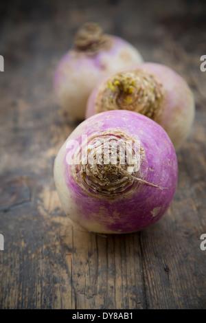 May turnip (Brassica rapa ssp. rapa var. majalis) on wooden table - Stock Photo