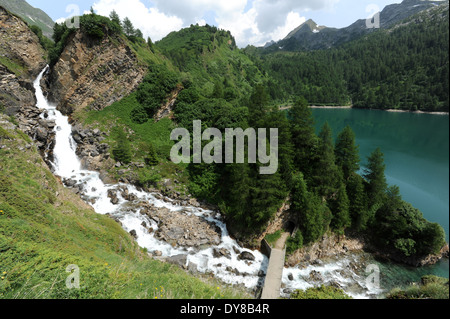 Switzerland, Ticino, Ritom, Piora, waterfall, rock, cliff, lake, scenery - Stock Photo