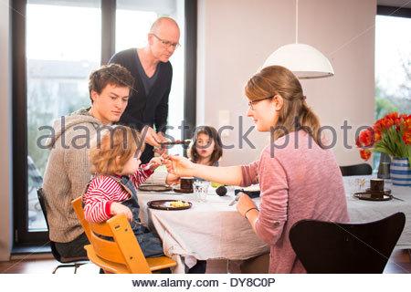 Young family having breakfast - Stock Photo