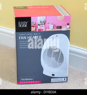 Electric Oscillating Fan in Outer Packaging in a Domestic Room, UK - Stock Photo