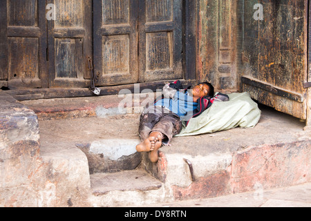 Homeless Person Is Sleeping Barefoot In The Park On A