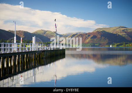 Lake scene with jetty, trees and hills. The Lake District Cumbria, England, United Kingdom. - Stock Photo