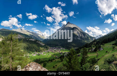 View town village field meadow trees summer mountains hills Les Hauderes Val d'Herens Wallis Valais Switzerland - Stock Photo