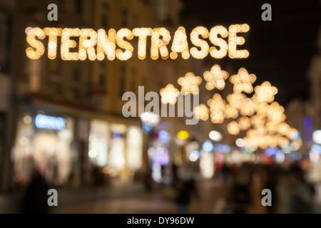 Germany, North Rhine-Westphalia, Bonn, Festive decorated shopping street - Stock Photo