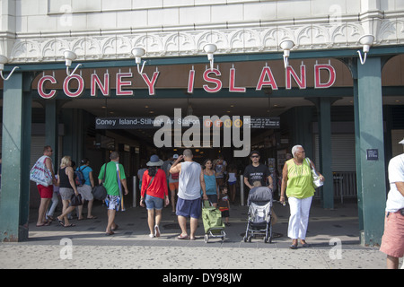 People arrive at Coney Island via the subway at Stillwell Ave. Station on their way to the beach, amusement park - Stock Photo