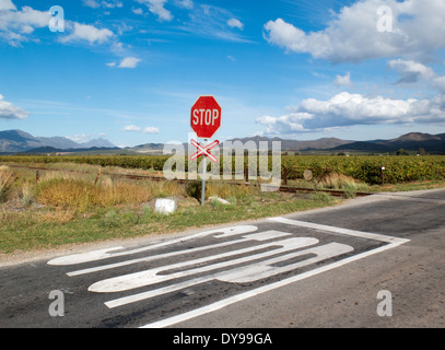 Stop sign at unmanned railway level crossing in the Western Cape South Africa - Stock Photo