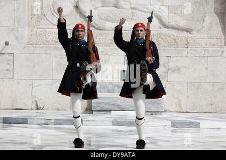 Athens, Greece. 10th Apr, 2014. Evzones perform the Changing of the Guard Ceremony at the Tomb of the Unknown Soldier - Stock Photo