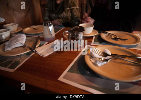 New England maple syrup house restaurant after a pancake breakfast with syrup and pickles. - Stock Photo