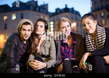 Friends hanging out together outdoors - Stock Photo