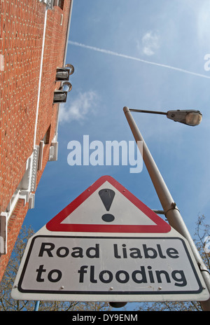 road liable to flooding sign with exclamation mark above, near the river thames at putney, southwest london, england - Stock Photo