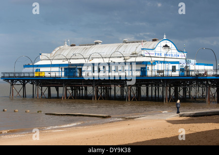 The pier at Cleethorpes, North East Lincolnshire, one walker on the beach - Stock Photo
